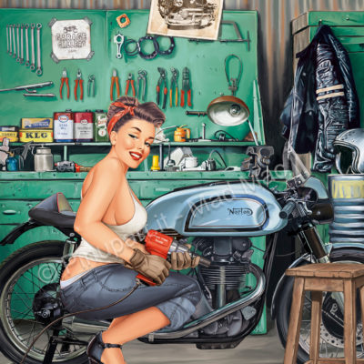 A mechanic pin-up in the garage that makes tuning of a 1953 Norton, a classic cafe racer ready for racing competitions.