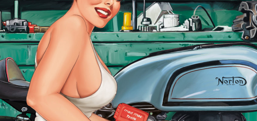 Mechanic Pin-Up in a motorbike garage: tuning of a classic!